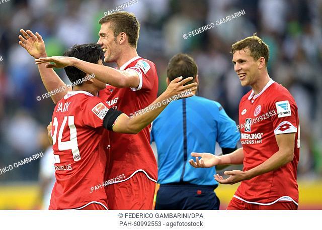 Mainz' Joo-Ho Park (l-r), Stefan Bell andFabian Frei celebrate after the German Bundesliga soccer match between Borussia Moenchengladbach and FSV Mainz 05 in...