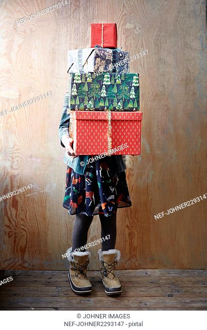 Girl holding Christmas presents