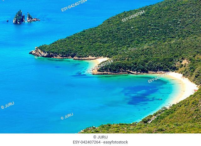 Summer sea coastal landscape (with sandy beach) of Nature Park Arrabida in Setubal, Portugal. All people are unrecognizable