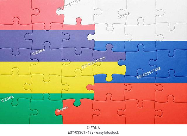 puzzle with the national flag of russia and mauritius . concept