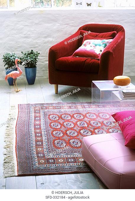 Old Persian carpet in modern sitting room
