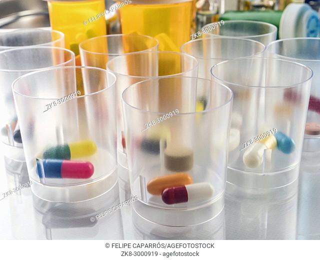 Daily medication at a hospital table, conceptual image
