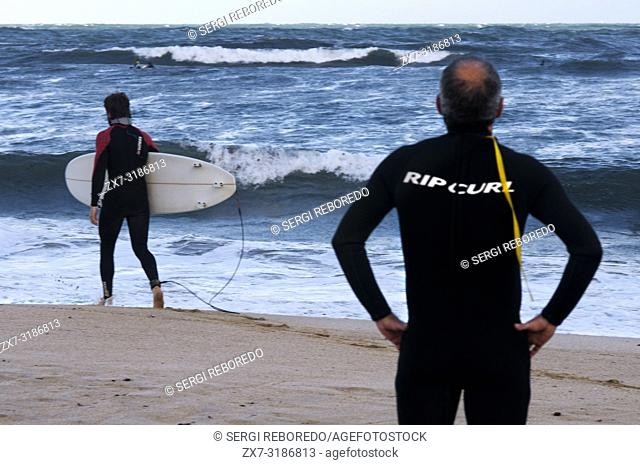 Surfer in beach. Donostia. San Sebastian. Euskadi. Basque country. Spain. Europe