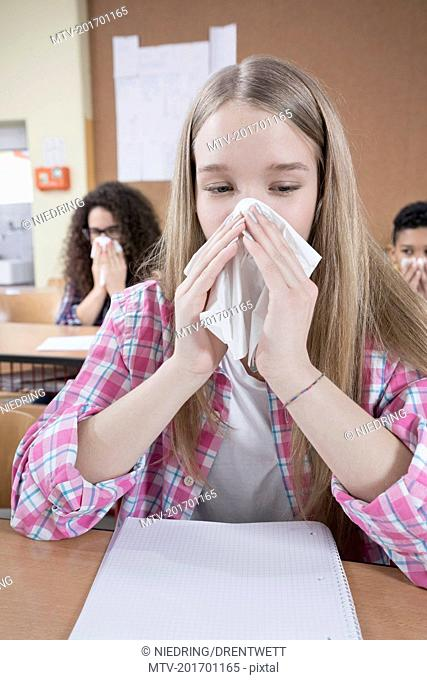 University student blowing nose with handkerchief, Bavaria, Germany