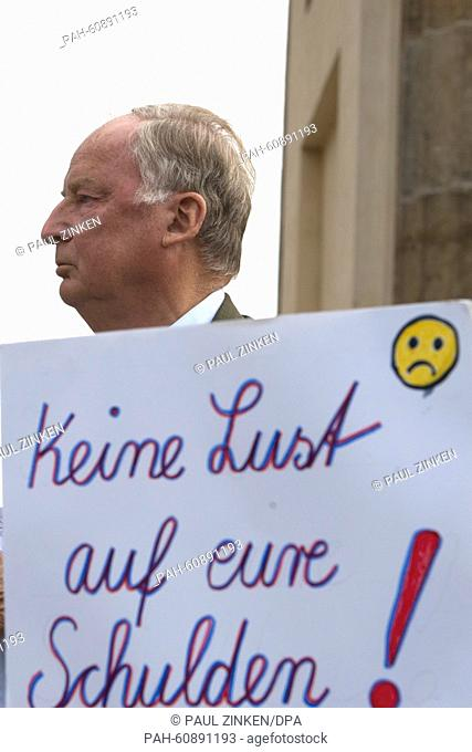 Alexander Gauland, vice party leader of the Alternative for Germany (AfD), stands behind a poster reading 'Keine Lust auf eure Schulden' (lit