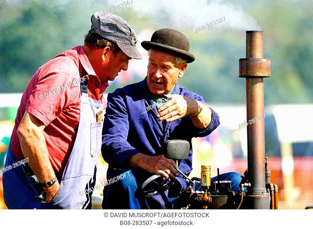 Owners with vintage steam engine at steam rally. Derbyshire. England