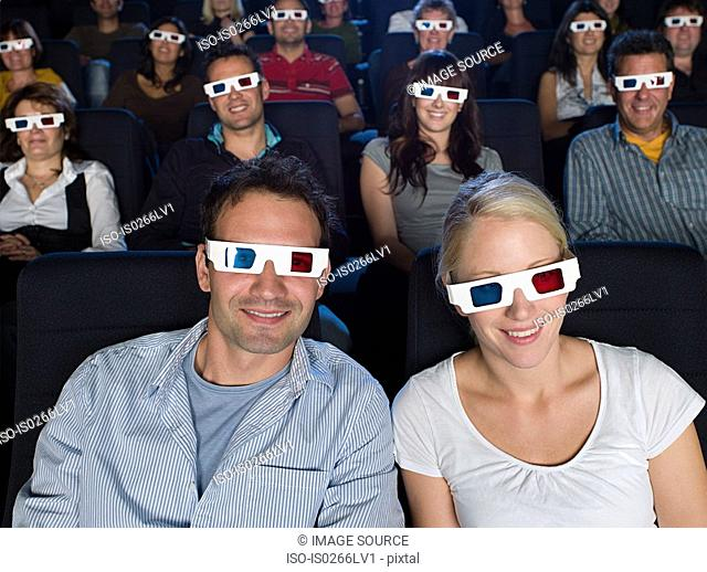 A couple watching a 3d movie