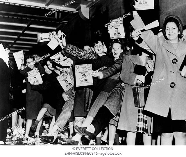 Teenage girls waiting for singer Frank Sinatra to arrive at the Paramount Theatre. 1945 in New York City. - (BSLOC-2014-17-78)