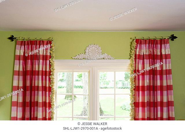 WINDOW TREATMENTS: stationary curtain rods hold pink and white buffalo check curtains with green tassel trim, lime green walls