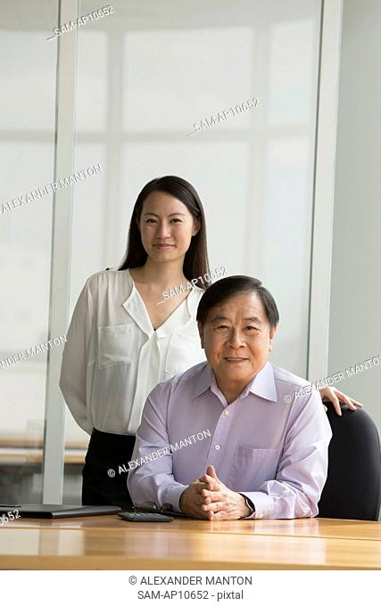 Singapore, Portrait of two business people in office