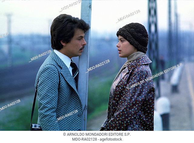 Italian actor, director and scriptwriter Michele Placido and Italian actress Ornella Muti (Francesca Romana Rivelli) speaking in the film Come Home and Meet My...