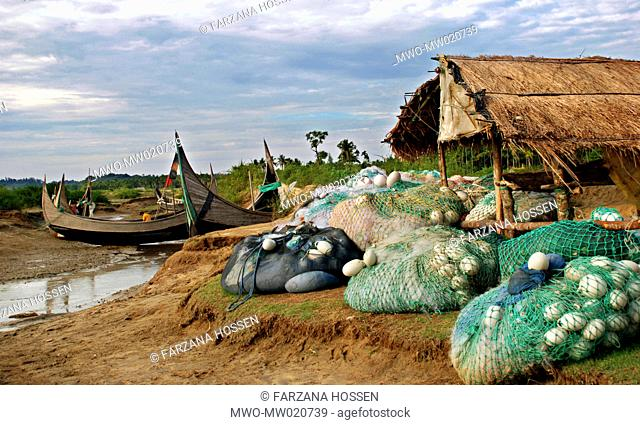 Traditional fishing boats or 'Sampans' and nets at a fishing village in Monkhali Upazila, in Cox's Bazar Fishing is the chief occupation of most of the people...
