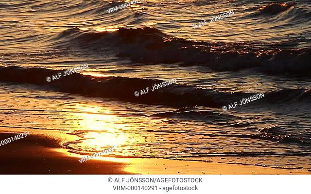 Waves in sunset in Swinoujscie, Poland