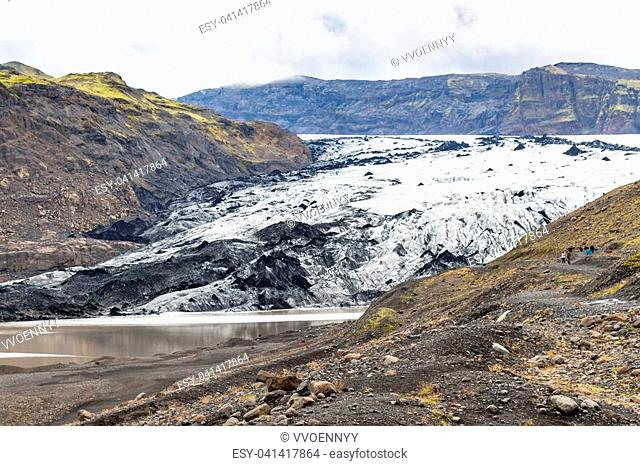 travel to Iceland - view of Solheimajokull glacier (South glacial tongue of Myrdalsjokull ice cap) in Katla Geopark on Icelandic Atlantic South Coast in...