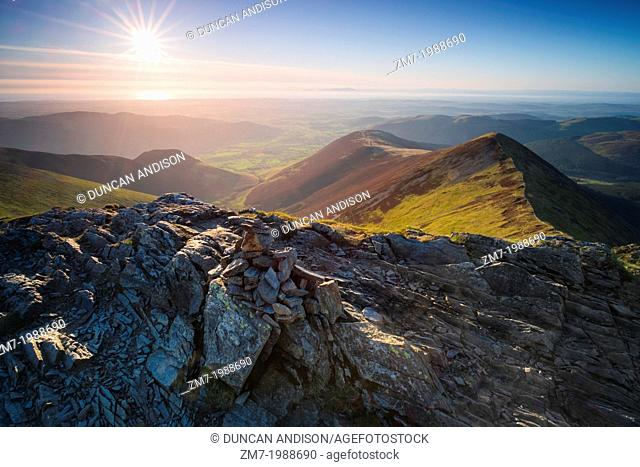 Looking towards Ladyside Pike and Hope Gill from the summit of Hopegill Head at sunset in the Lake District