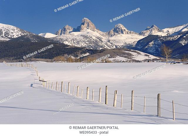 Mount Owen Grand Teton Middle Teton and South Teton in winter from Idaho with fence