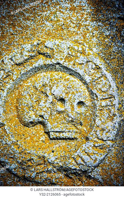 Close up of stone skull on ancient tomb, Sweden