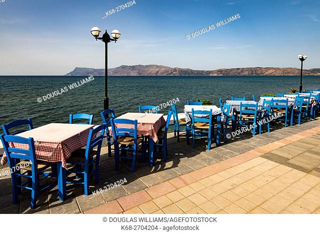 tables and chairs at a restaurant on the north coast of Crete, Greece