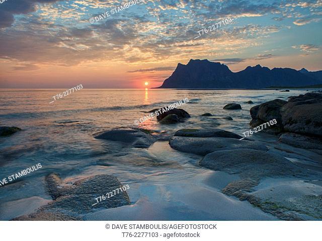 the midnight sun over the Arctic from Uttakleiv Beach in the Lofoten Islands, Norway