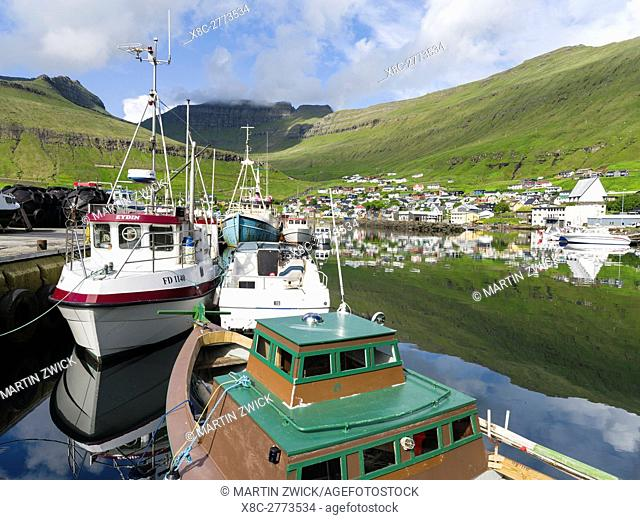 The harbour of the small town Fuglafjordur. The island Eysturoy one of the two large islands of the Faroe Islands in the North Atlantic
