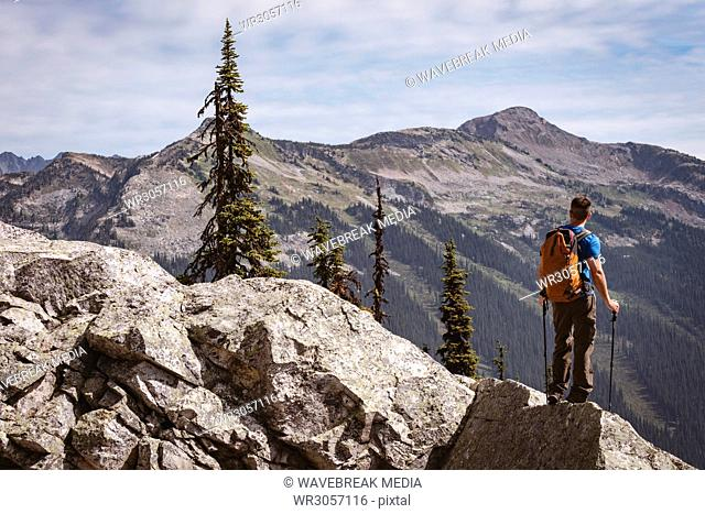 Male hiker looking at solar eclipse