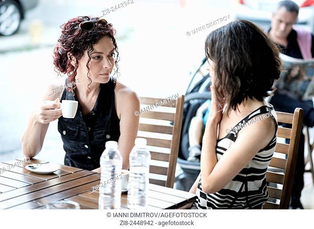 Girlfriends meet over coffee
