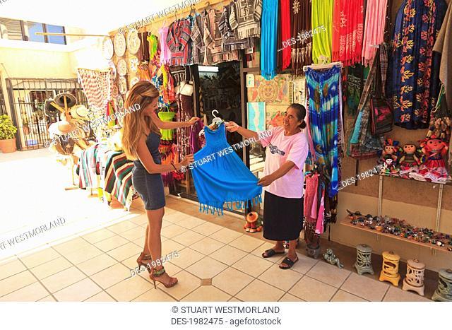 women looking at a dress at a downtown shop, todos santos baja california sur mexico