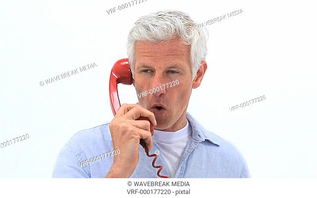 Mature man using his phone against a white background