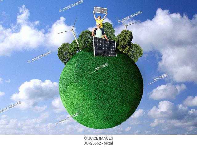 Grass globe with people, wind turbines and solar panels against blue sky with clouds