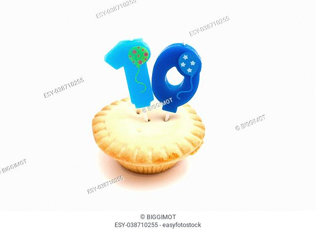 cupcake with ten years birthday candle on white