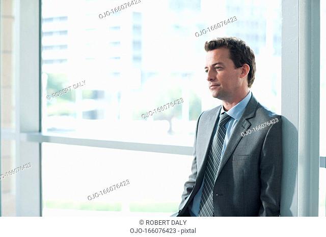 Portrait of smiling businessman in corridor