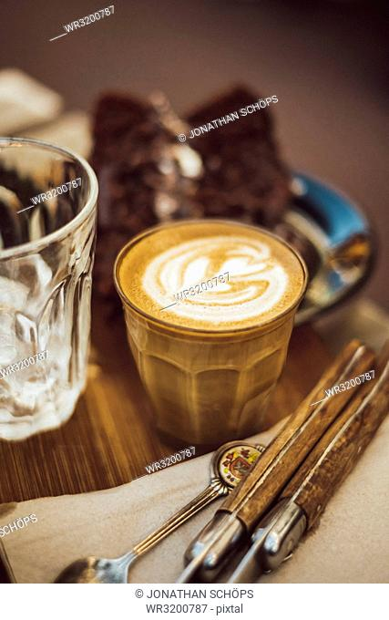 Coffee in the glass with milk froth in heart shape