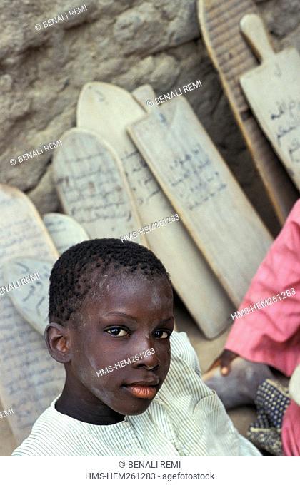 Mali, Mopti Region, Djenne, listed as World Heritage by UNESCO, student at a Koranic school