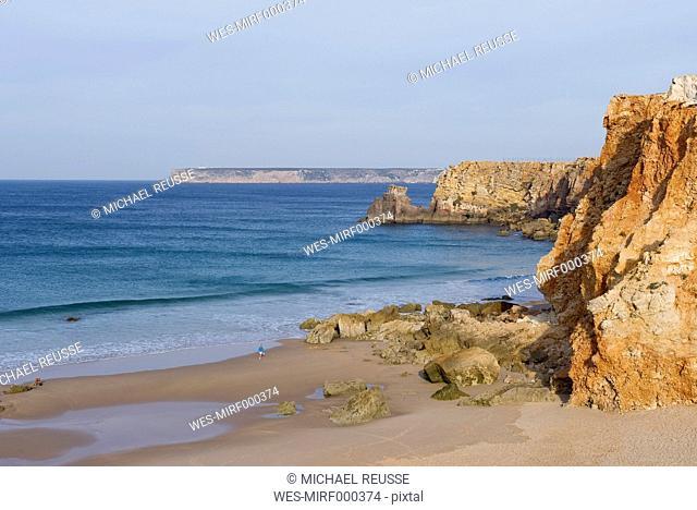 Portugal, Algarve, Senior woman jogging by coast
