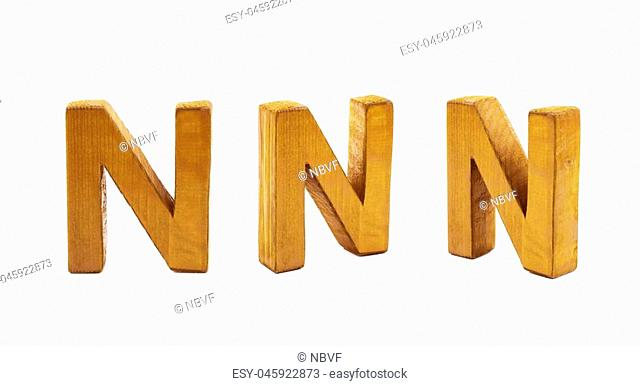 Single sawn wooden N letter symbol in different angles and foreshortenings isolated over the white background