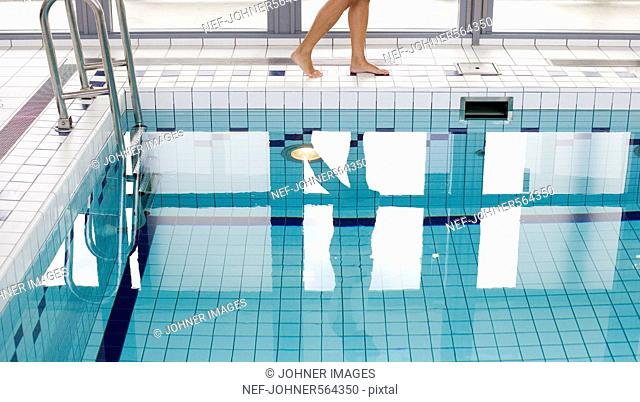A woman by a swimmingpool, Sweden