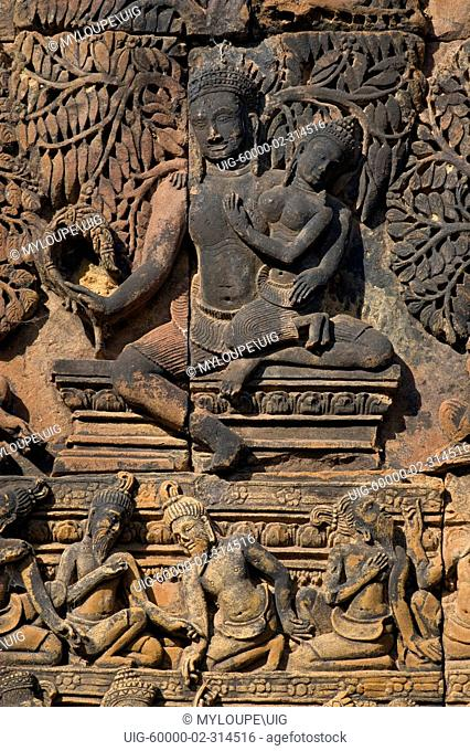 Banteay Srei with bas relief in red sandstone showing Shiva & Parvati E pediment of S Library, 10th century Khmer architecture at Angkor Wat - Siem Reap