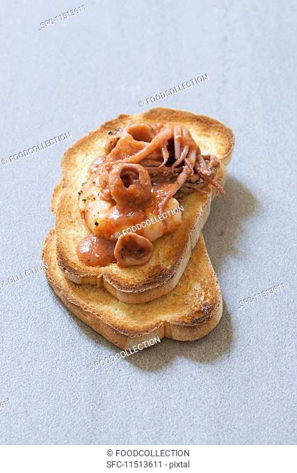 Bruschetta al caciucco (grilled bread topped with seafood, Italy)
