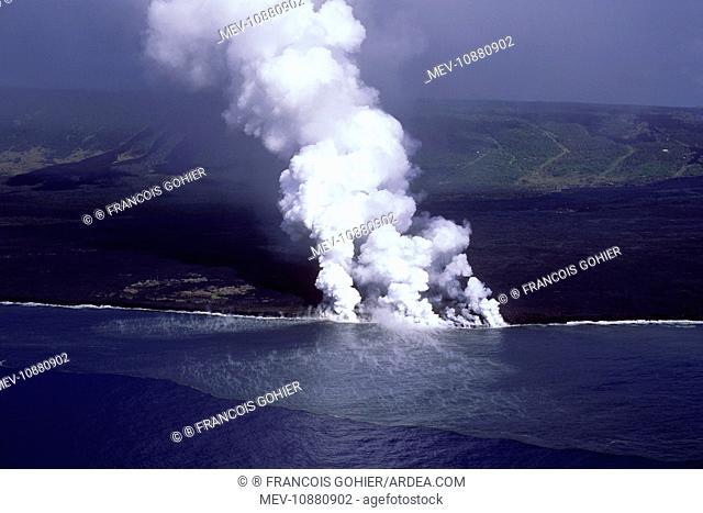 USA - Hawaii - Big Island - Eruption of the Pu'u O'o Vent - a vent of the Kilauea volcano (Volcano Kilauea). the lava flow reaches the Pacific Ocean - steam...