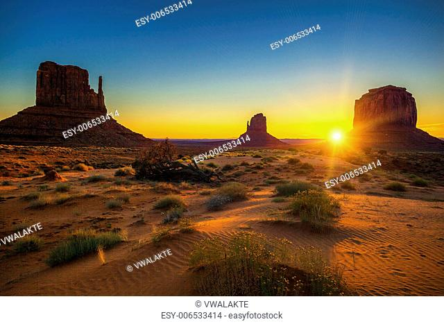 Horizontal view of sunrise at Monument Valley, USA