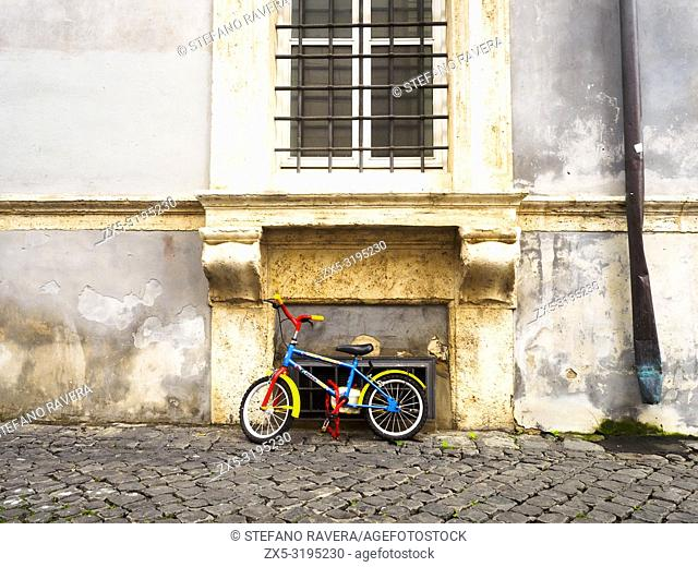 Kid Bicycle under a window in Trastevere - Rome, Italy