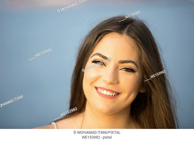 Happy beautiful young woman smiling outdoors