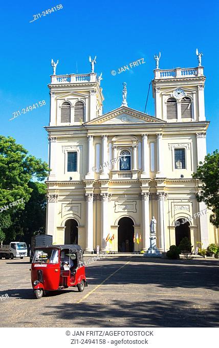 Sint Mary Church with red tuktuk in Negombo, Sri Lanka