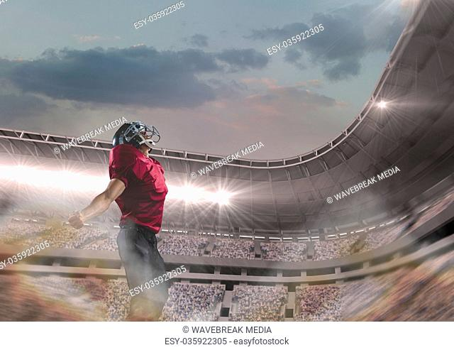 american football player standing in stadium
