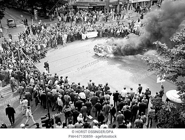 Burning car in Duesseldorf during a student demonstration on 12 June 1968. Students had brought an old, not functional car to burn