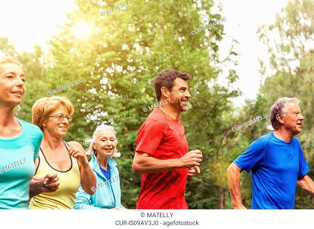 Group of adults running outdoors