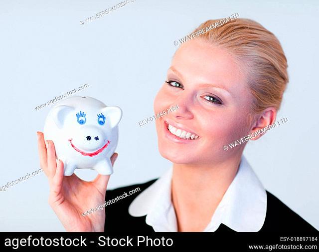 Pretty business woman holding a piggy Bank