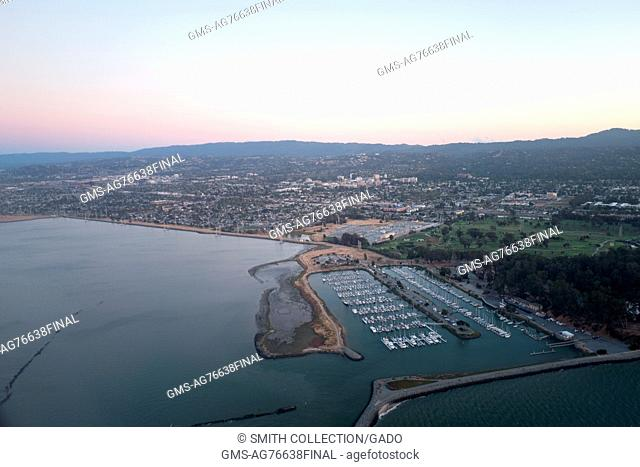 Aerial view at dusk of Coyote Point Yacht Harbor and the Silicon Valley town of San Mateo, California, July, 2016
