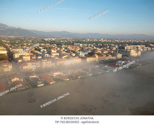Italy, Tuscany, Viareggio, beach with fog