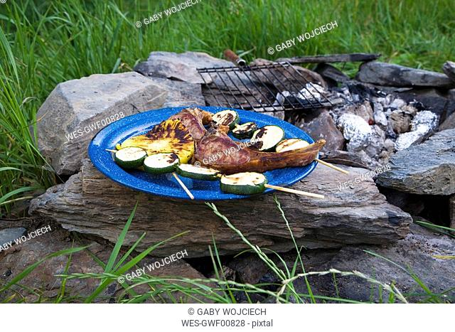 Barbecue, lamb chops and zucchini skewers